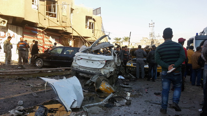 Iraqis inspect the aftermath of a car bomb explosion in Baghdad's eastern neighbourhood of al-Jadidah on January 20, 2014 (AFP Photo / Ali Al-Saidi)