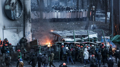 Opposition supporters during clashes with riot police outside Dynamo stadium in Kiev. (RIA Novosti/Andrey Stenin)