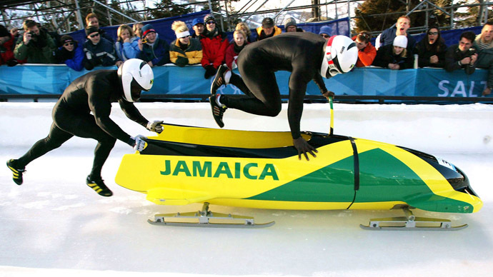 Lascelles Oneil Brown (L) and Winston Alexander Watt of the Jamaica-1 team leap into their sled at the start of heat three of the two-man bobsleigh competition at the Salt Lake 2002 Winter Olympic Games, February 17, 2002 in Park City (Reuters/Peter Andrews)