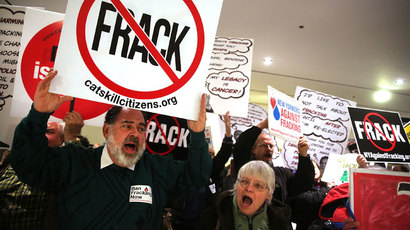 Anti-fracking protesters gather outside of the auditorium before New York Gov. Andrew Cuomo gives his fourth State of the State address on January 8, 2014 in Albany, New York.(AFP Photo / Spencer Platt)