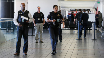 LAPD officers walk around terminal 3 after a shooting at Los Angeles airport (LAX), California November 1, 2013.(Reuters / Lucy Nicholson)