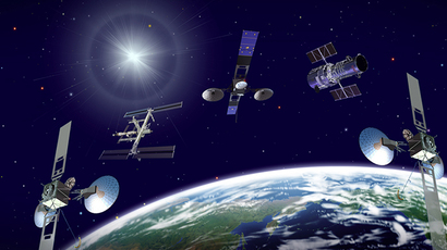 Three TDRS satellites, the International Space Station (ISS) and Hubble Space Telescope orbit a blue-green Earth in this artist's concept. (Credit: NASA/Goddard Space Flight Center)