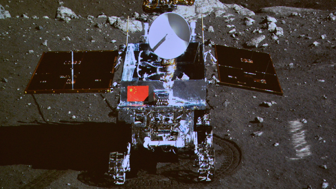 "A photograph of the giant screen at the Beijing Aerospace Control Center shows photo of the Yutu, or ""Jade Rabbit"" lunar rover taken by the camera on the Chang'e 3 probe during the mutual-photograph process, in Beijing (Reuters / Stringer)"