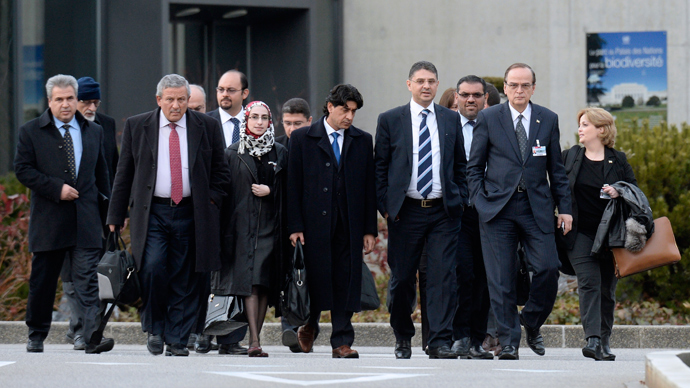 "Syrian opposition chief negotiator Hadi al-Bahra (2nd R) and General Secretary of the Syrian National Council Badr Jamous (4ht R) arrive with the opposition delegation to attend a meeting at the ""Geneva II"" peace talks dedicated to the ongoing conflict in Syria, on January 25, 2014, in Geneva (AFP Photo)"