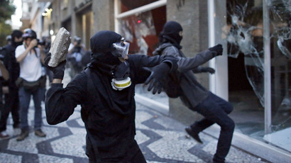 Demonstrators attack a Bradesco bank branch during a protest against the 2014 World Cup in Sao Paulo January 25, 2014. (Reuters/Nacho Doce)