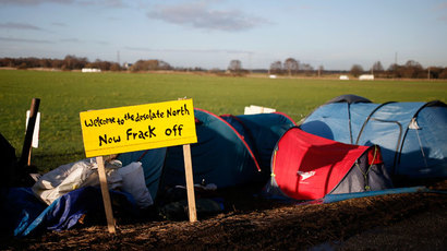 A sign stands outside a protest camp at the entrance to the IGas Energy exploratory gas drilling site at Barton Moss near Manchester in northern England January 13, 2014.(Reuters / Phil Noble)