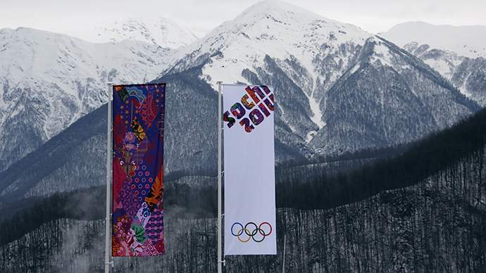 Flags are pictured in front of mountains at the Sanki sliding center at the Rosa Khutor Alpine Resort in Krasnaya Polyana near Sochi (Reuters / Fabrizio Bensch)