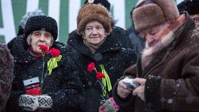 People watch a parade on the 70th anniversary of Leningrad liberation from the Nazi siege on Nepokoryonnykh Prospekt in St. Petersburg.(RIA Novosti / Anna Volkova)