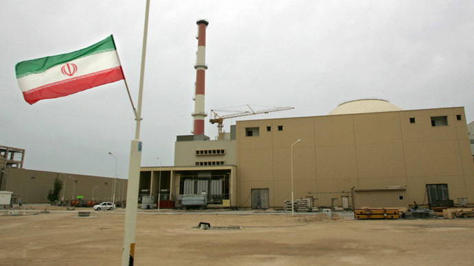 File picture dated April 3, 2007 shows an Iranian flag outside the building housing Iran's first and much-delayed nuclear power plant near the southern port city of Bushehr, 1200 kms south of Tehran, which is expected to go online on August 21. (AFP Photo)