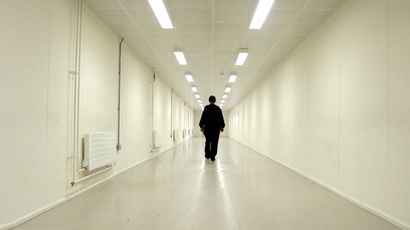A Group 4 security officer walks down one of the corridors of Yarl's Wood Immigration Removal Centre (Reuters)