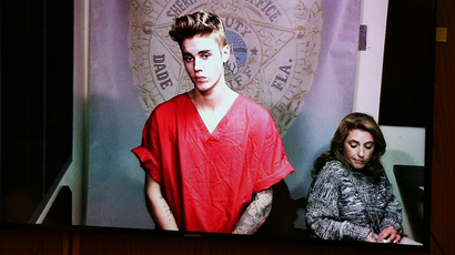 Pop singer Justin Bieber appears via video conference in his first court appearance since being arrested early morning in Miami, Florida January 23, 2014. (Reuters / Walter Michot / Pool)