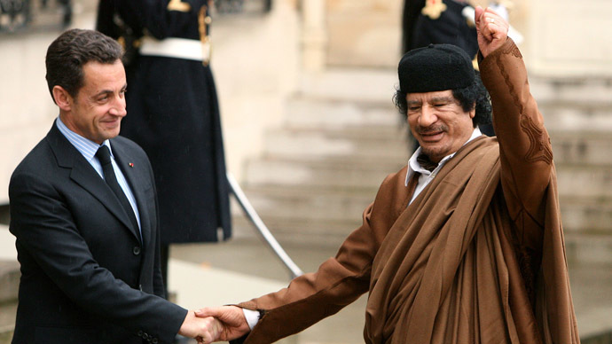 France's President Nicolas Sarkozy (L) greets Libyan leader Muammar Gaddafi in the courtyard of the Elysee Palace in Paris as he arrives for a five day official visit December 10, 2007. (Reuters/Jacky Naegelen)