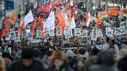 Participants attend the March for Freedom, staged in Moscow in support of the persons accused over the criminal case over mass disorders and application of force against representatives of authority during riots on Bolotnaya Square on May 6, 2012. (RIA Novosti/Kirill Kallinikov)