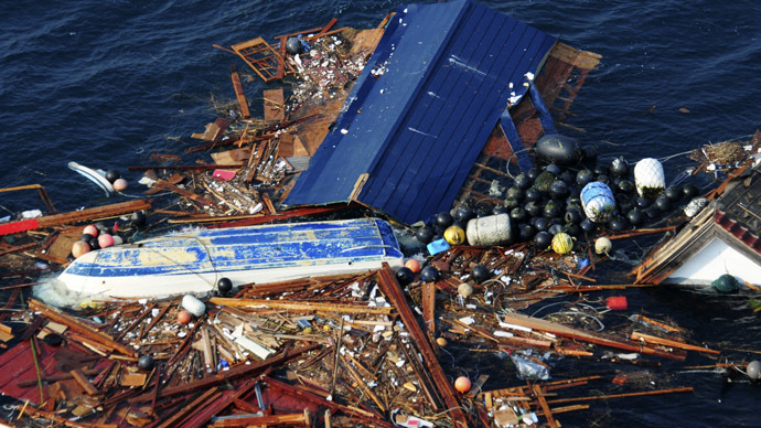 Debris is pictured floating in the Pacific Ocean, in this photograph taken on March 13, 2011 and released on March 14. (Reuters)