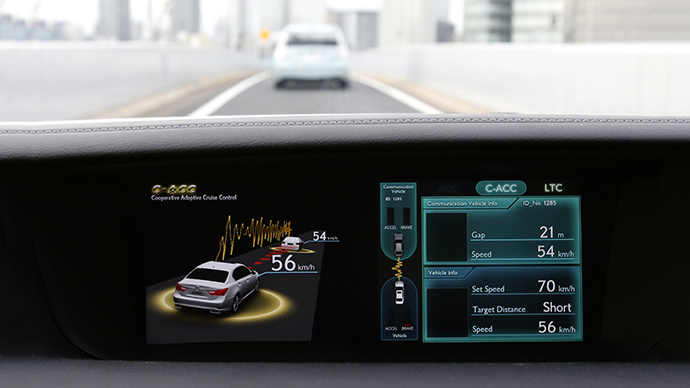A display on a Toyota test car shows the Cooperative-adaptive Cruise Control, which uses 700-Mhz band vehicle to vehicle ITS to transmit acceleration and deceleration data to maintain inter-vehicle distance (Reuters / Yuya Shino)