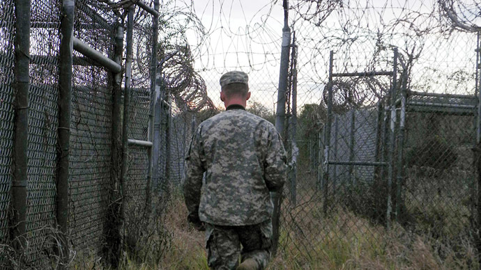 A soldier walks through an abandoned camp at the US Naval Base in Guantanamo Bay, Cuba (AFP Photo)