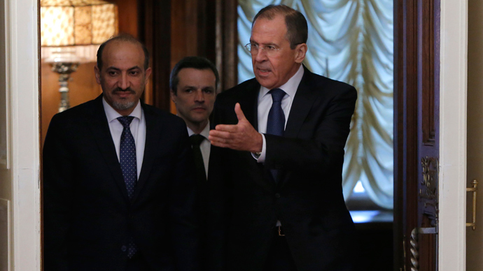 Russia's Foreign Minister Sergei Lavrov (R) and Syrian opposition leader Ahmad Jarba arrive for a meeting in Moscow February 4, 2014 (Reuters / Maxim Shemetov)