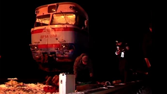 13 killed as commuter train rips apart shuttle bus on crossing in Ukraine