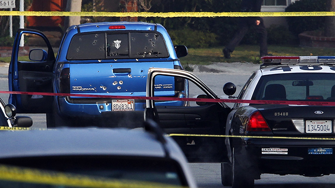 Police detectives investigate a shooting incident involving a blue Toyota Tacoma pickup truck in Torrance, California, February 7, 2013. Police opened fire on the vehicle in a case of mistaken identity while searching for former Los Angeles police officer Christopher Jordan Dorner (Reuters / Patrick Fallon)