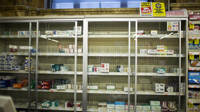 Near empty cigarette shelves are seen at a CVS store in New York February 4, 2014. (Reuters / Eric Thayer)