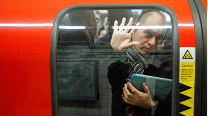 A passenger is squeezed up against a door in one of the few tube trains which became overcrowded during rush hour at Oxford Circus underground station in London February 5, 2014. (Reuters / Luke MacGregor)