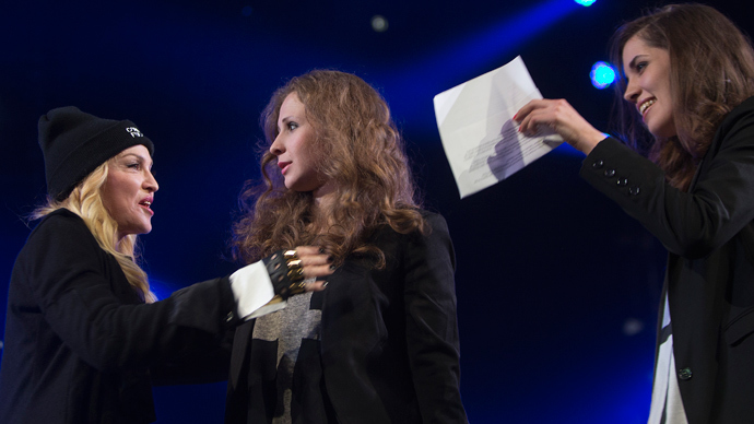 Madonna (L) introduces Russian punk rock band Pussy Riot members Nadezhda Tolokonnikova (R) and Maria Alyokhina during the Amnesty International benefit concert in the Brooklyn borough of New York February 5, 2014. (Reuters / Carlo Allegri)