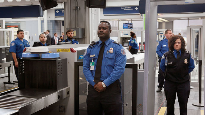 Transportation Security Administration (TSA) officers staff a checkpoint at O'Hare International Airport on March 15, 2010 in Chicago, Illinois.(AFP Photo / Scott Olson)