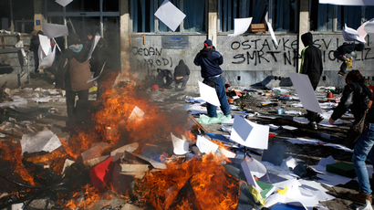 Protesters stand near a fire set in front of a government building in Tuzla February 7, 2014. (Reuters / Dado Ruvic)