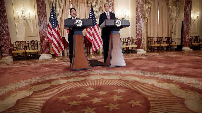 Secretary of State John Kerry (R) and Japanese Foreign Minister Fumio Kishida (L) deliver a joint statement at the State Department February 7, 2014 in Washington, DC.(AFP Photo / Win McNamee)