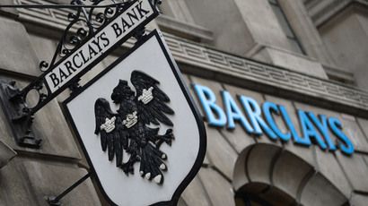 Logos are seen outside a branch of Barclays bank in London (Reuters / Toby Melville)