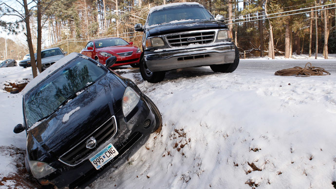 A car sits in a ditch along with other abandoned cars after running off the roadway due to a snow storm in Atlanta, Georgia, January 29, 2014. (Reuters / Tami Chappell)