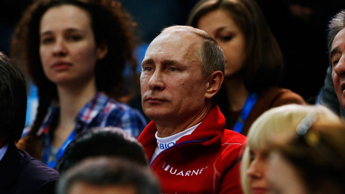 Russian President Vladimir Putin watches from the stands during the Team Ladies Free Skating Program at the Sochi 2014 Winter Olympics, February 9, 2014.(Reuters / Alexander Demianchuk)