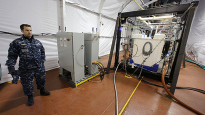 The Field Deployable Hydrolysis System used to destroy and neutralize chemical weapons is watched by U.S. Navy Commander Bill Speaks as it sits aboard the MV Cape Ray (Reuters / Larry Downing)