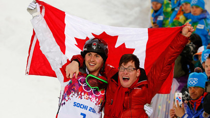 Winner Canada's Alex Bilodeau and his brother Frederic celebrate following the freestyle skiing moguls competition at the 2014 Sochi Winter Olympic Games in Rosa Khutor February 10, 2014 (Reuters / Mike Blake)