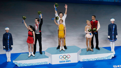 Russia's Ksenia Stolbova and Fedor Klimov stand in second place, Russia's Tatiana Volosozhar and Maxim Trankov stand in first place and Germany's Aliona Savchenko and Robin Szolkowy stand in third place on the podium after the Figure Skating Pairs Free Skating Program at the Sochi 2014 Winter Olympics, February 12, 2014 (Reuters / Phil Noble)
