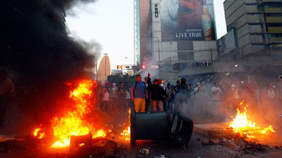 Demonstrators make a barricade of burning garbage during a protest against Venezuela's President Nicolas Maduro's government in Caracas February 12, 2014.(Reuters / Carlos Garcia Rawlins)