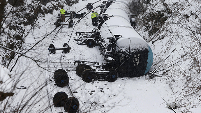 Emergency personnel examine the wreckage of a train derailment near Vandergrift, Pennsylvania February 13, 2014. (Reuters / Jason Cohn)