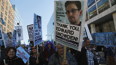 "Demonstrators hold signs supporting former NSA contractor Snowden as they march at ""Stop Watching Us: A Rally Against Mass Surveillance"" near the U.S. Capitol in Washington (Reuters / Jonathan Ernst)"