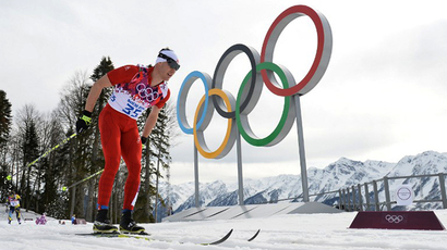 Switzerland's Dario Cologna competes to win gold in the Men's Cross-Country Skiing 15km Classic at the Laura Cross-Country Ski and Biathlon Center during the Sochi Winter Olympics on February 14, 2014 in Rosa Khutor near Sochi. (AFP Photo / Alberto Pizzoli)