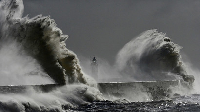 Large waves hit the lighthouse and harbour at high tide at Newhaven in Sussex, southern England February 15, 2014. (Reuters / Toby Melville)