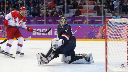 Russia's Pavel Datsyuk (L) scores on Team USA's goalie Jonathan Quick during the second period of their men's preliminary round ice hockey game at the 2014 Sochi Winter Olympic Games, February 15, 2014.(Reuters / Mark Blinch)
