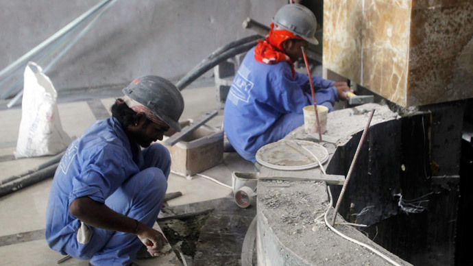 Labourers work at a construction site in Doha.(Reuters / Stringer)