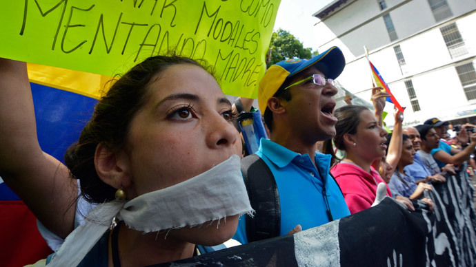 Students take part in an anti-government protest in Caracas on February 17, 2014. (AFP Photo / Juan Barreto)