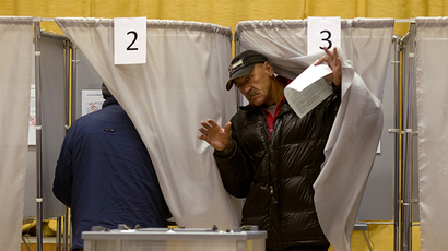 Tomsk residents at a polling station during the mayoral election. (RIA Novosti / Yakov Andreev)