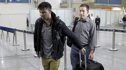 David Miranda (L) — the Brazilian partner of Glenn Greenwald, a US journalist with Britain's Guardian newspaper who worked with intelligence leaker Edward Snowden to expose US mass surveillance programmes -- is pictured at Rio de Janeiro's Tom Jobim international airport upon his arrival on August 19, 2013. (AFP Photo / Marcelo Piu)