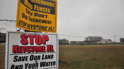 Signs attached to a fence on the property of Jim Tarnick, a farmer opposed to the controversial Keystone XL pipeline, are pictured April 17, 2013 in Fullerton, Nebraska.(AFP Photo / Guillaume Meyer)