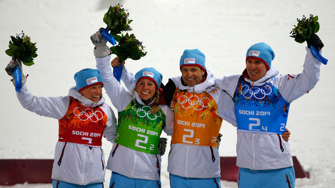 (L-R) Winner Norway's Tora Berger, Tiril Eckhoff, Ole Einar Bjoerndalen and Emil Hegle Svendsen pose on the podium during a flower ceremony of the mixed relay biathlon race at the 2014 Sochi Winter Olympics February 19, 2014.(Reuters / Carlos Barria)