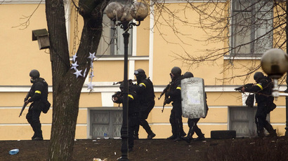 Armed police take up positions during clashes with anti-government protesters in Independence Square in Kiev February 20, 2014. (Reuters/Maksim Liukov)
