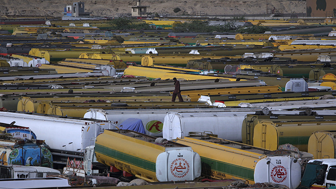A man walks atop of fuel tankers, which were used to carry fuel for NATO forces in Afghanistan. (Reuters / Akhtar Soomro)