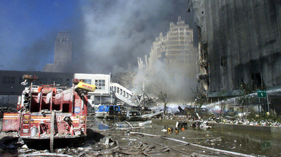 Fire trucks sit amid the rubble near the base of the destroyed World Trade Center in New York on September 11, 2001.(AFP Photo / Peter Morgan)